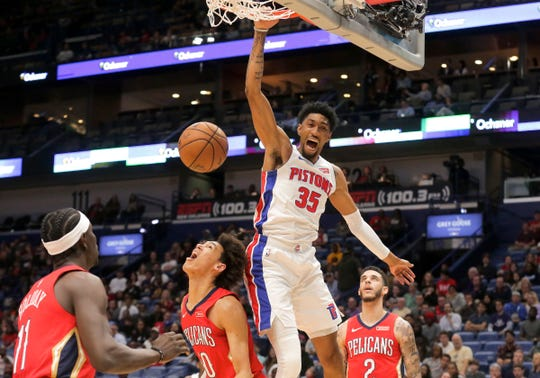 Detroit Pistons forward Christian Wood (35) dunks over New Orleans Pelicans center Jaxson Hayes (10) during the first quarter at the Smoothie King Center.