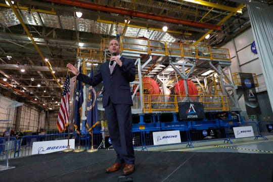 NASA administrator Jim Bridenstine speaks in front of NASA's Space Launch System core stage and engines that will be used in the Artemis1 mission, at the NASA Michoud Assembly Center in New Orleans, Monday, Dec. 9, 2019.