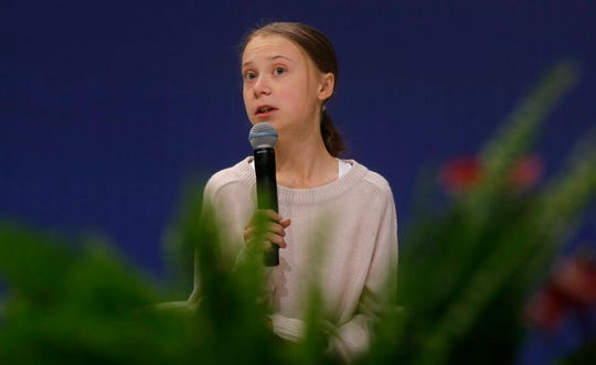 Climate activist Greta Thunberg speaks during a meeting with leading climate scientists at the COP25 summit in Madrid, Spain, Tuesday, Dec. 10, 2019.