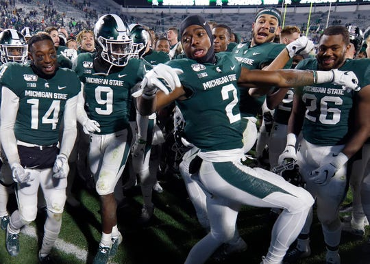 Michigan State players watch Julian Barnett dance as they celebrate following a 19-16 win against Maryland in East Lansing.