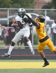 Detroit Cass Tech Kalen King, left, is a three-sport standout, putting together an outstanding junior season by scoring 13 TDs while getting in on 20 tackles defensively while breaking up five passes and intercepting a pass.