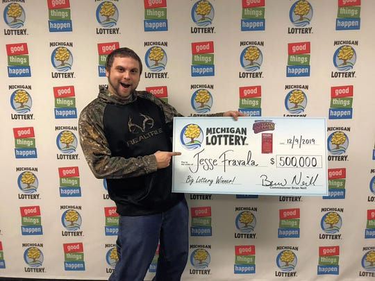 Jesse Fravala, 23, won $500,000 playing the Wild Time game from the Michigan Lottery, lottery officials said Monday.