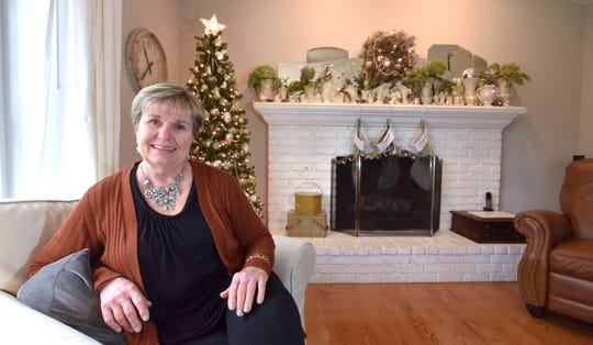 Sandy Vartoogian, an antiques dealer from Livonia, poses in her Livonia. She loves infusing antiques into her holiday decor.