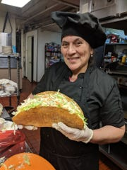 Chef Teresa Alfaro of Los Alfaro's with her new footlong taco.