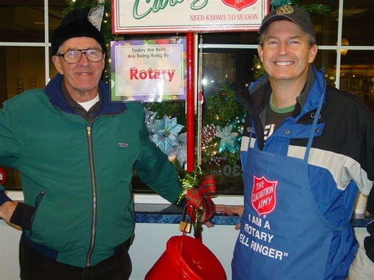 John S. Pelletier, left, rings bells with Dr. Matt Doll during one of Rotary's bell ringing nights. Pelletier helped start the Morning Rotary in 1989.