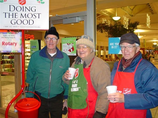 During Rotary bell ringing, John S. Pelletier drove to all the kettles and brought food, drink, and company to Rotary members. Pictured with Pelletier, left, are John Earl Wohlust and Tom Guilfoile.