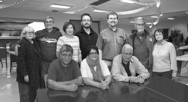 The original Fond du Lac Community Christmas dinner leadership team. Pictured are, back row, from left: Bonnie Burroughs-Bachhuber, Phil Bachhuber, Louann Fauska, Bruce Fauska, Mike Kalsbeek, Roger Funk and Marie Funk; front row, from left: Michael Turk, Catherine Leventhal and Todd Culver.
