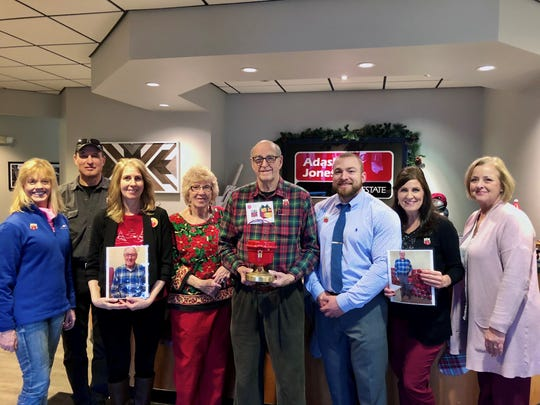 Family and friends of John S. Pelletier gathered at Adashun Jones Dec. 5, 2019 to pay tribute. One of the counter kettles which Pelletier used to coordinate can be found at Adashun Jones, where his grandson, Steven Krueger works. Pictured are, from left: Rotary Member Cindy Warner; Tom Wellnitz; Wendy Pelletier, daughter; Judi Walters; Bob Pelletier, brother; Steven Krueger, grandson; Debbie Krueger, daughter; and Rotary Member Barb Senn. Not pictured: John L. Pelletier, son, and Kristy Pelletier, granddaughter.