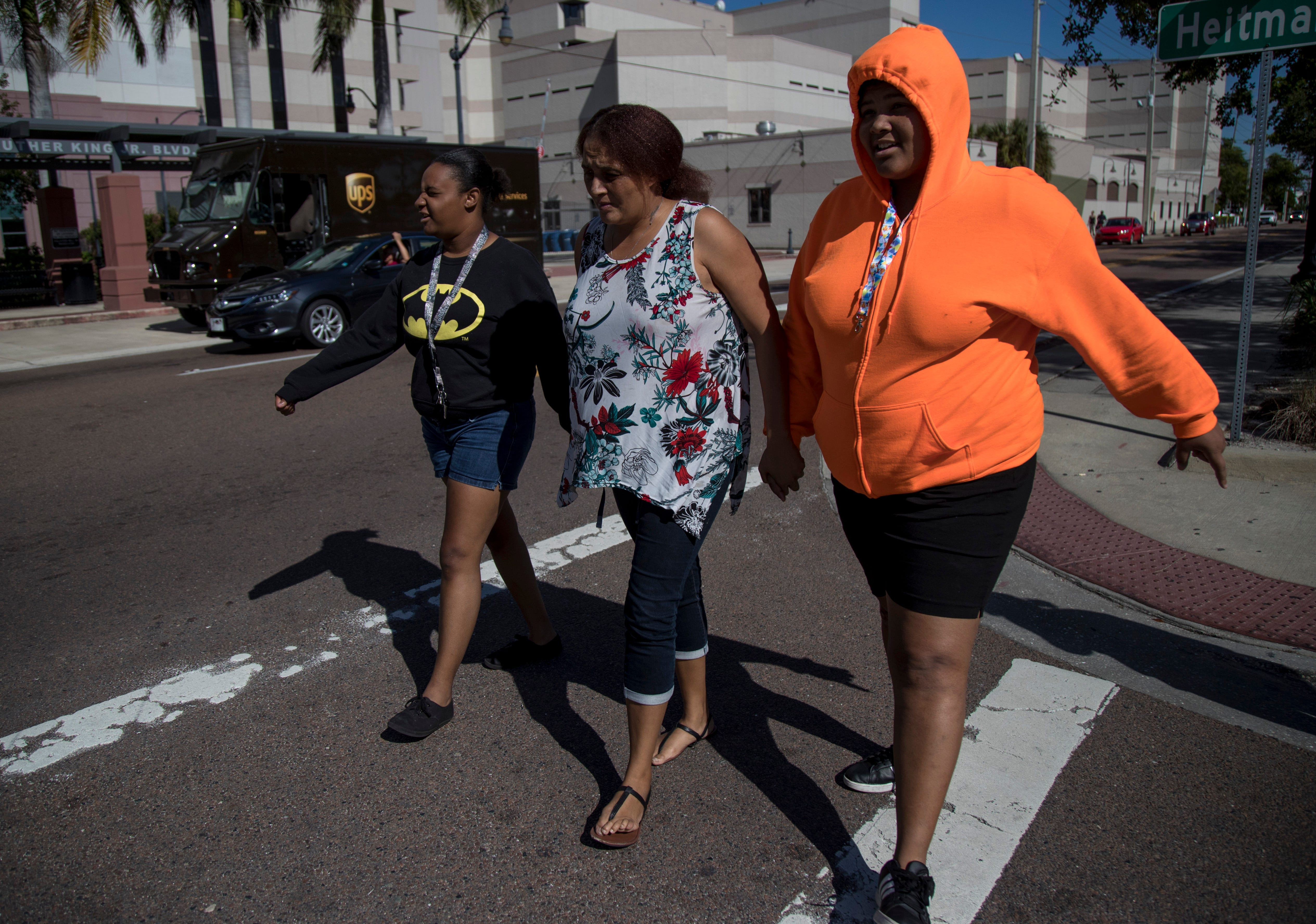 Dawn Hoshor and her daughters Kourtney, left, and Anber walk toward the courthouse hoping that Anber will be able to come home on Nov. 21, 2019. The next morning they got the news that the magistrate would allow Anber to be reunified with her mom until her 18th birthday in December.