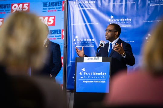 Darius Hall, a candidate for Greenville County Sheriff, responds to a question during their debate at Global Trade Park Monday, December 9, 2019.