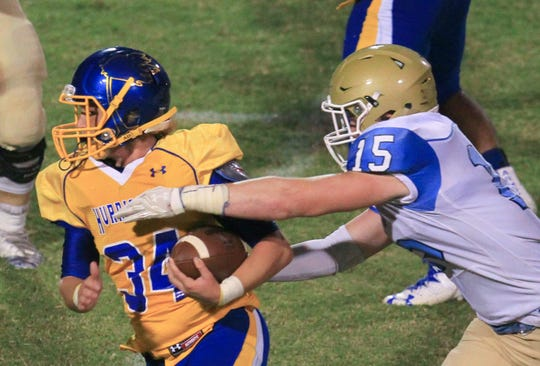 WrenÕs Jonathan Cobb(34) is tackled by Daniel's Jake Venables (15) after intercepting a pass during the fourth quarter at Wren High School in Piedmont in 2016.