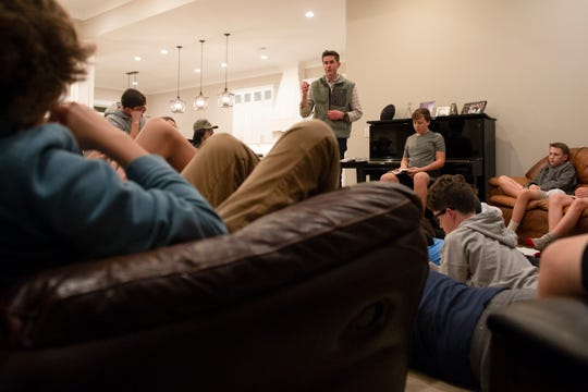 Will Snipes leads a bible study in the home of one of the attendees Thursday, Nov. 21, 2019.