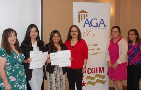The Association of Governmental Accountants Guam Chapter presented  Fall 2019 AGA scholarship recipients of the Herminia Dierking Scholarship to Justine Arida and Sophia Meneses from the University of Guam. The ceremony was held Nov. 20 at the Hilton hotel during the monthly general membership meeting. From left: Pam Aguigui, Meneses, Arida, Dr. Doreen Crisostomo, UOG School of Business & Public Administration, Debbie Ngata, and Pilar Pangelinan.
