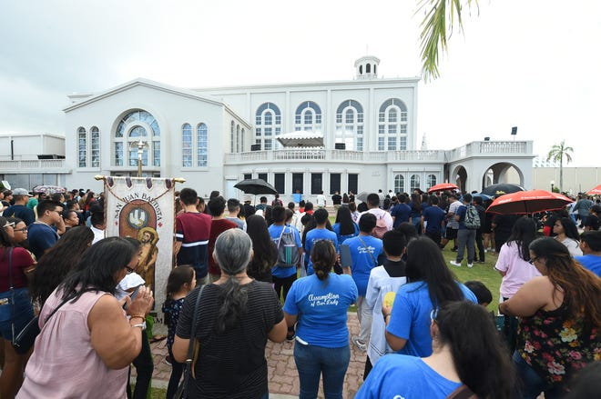 In this Dec. 9, 2019, file photo, Catholics celebrate the feast of Santa Marian Kamalen at the Dulce Nombre de Maria Cathedral-Basilica in Hagatña. Catholic parishes and schools are seeking to protect their own assets from being used to help pay Guam clergy sex abuse claims.
