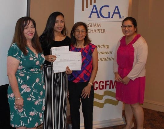The Association of Governmental Accountants Guam Chapter presented  Fall 2019 AGA scholarship to Kimberly Dela Cruz from Guam Community College on Nov. 20. From left: Pam Aguigui, AGA scholarship committee chairperson, Dela Cruz, Pilar Pangelinan, AGA president-elect/GCC professor, and  Debbie Ngata, AGA Guam president.