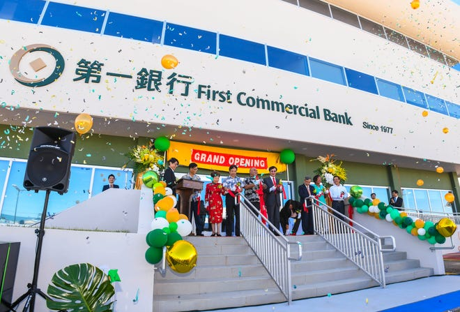 Balloons and confetti fly skyward during a ribbon cutting held in celebration for the grand opening of the First Commercial Bank branch in Tamuning on Tuesday, Dec. 10, 2019.