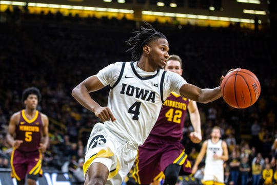 Iowa guard Bakari Evelyn (4) had been biding his time and searching for a role in his first 11 games for the Hawkeyes. On Dec. 21 against Cincinnati, Evelyn showed his true value with 15 points, seven rebounds and four assists.