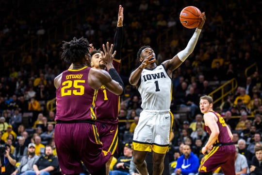 Iowa freshman Joe Toussaint, driving to the basket against Minnesota on Dec. 9, looks to be next in line to start at point guard. Senior Jordan Bohannon is out for the season after hip surgery.