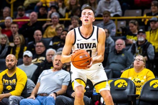 Iowa guard Joe Wieskamp (10) shoots a 3-point basket during a NCAA Big Ten Conference men's basketball game, Monday, Dec. 9, 2019, at Carver-Hawkeye Arena in Iowa City, Iowa.