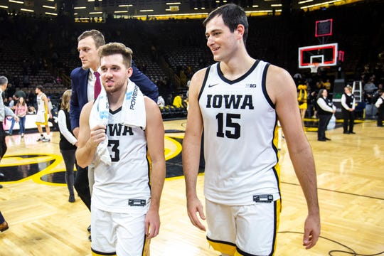 Iowa guard Jordan Bohannon (3) and Iowa forward Ryan Kriener (15) walk off the court together after a NCAA Big Ten Conference men's basketball game against Minnesota, Monday, Dec. 9, 2019, at Carver-Hawkeye Arena in Iowa City, Iowa.