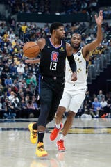 Dec 9, 2019; Indianapolis, IN, USA; Los Angeles Clippers forward Paul George (13) drives the basket against Indiana Pacers forward T.J. Warren (1) during the first quarter at Bankers Life Fieldhouse.