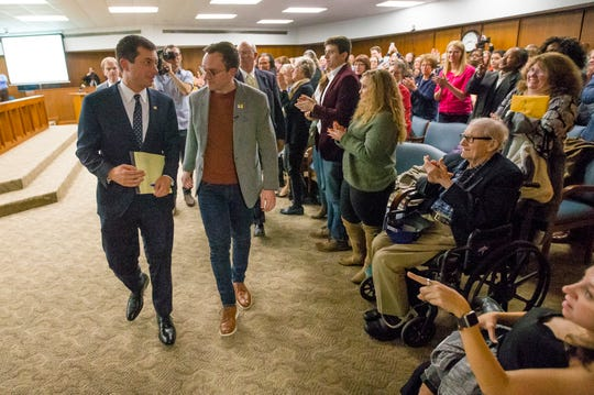 South Bend Mayor Pete Buttigieg exits with his husband Chasten Buttigieg during the South Bend Common Council Meeting Monday, Dec, 9, 2019 in the County City Building in downtown South Bend.