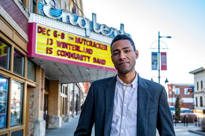 Andre Perry, executive director of the Englert Theatre, poses for a photo, Thursday, Dec. 5, 2019, along Washington Street in front of the Englert Theatre in Iowa City, Iowa.
