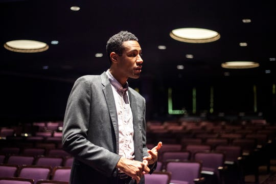 Andre Perry, executive director of the Englert Theatre, stands in the auditorium, Thursday, Dec. 5, 2019, at the Englert Theatre in Iowa City, Iowa.