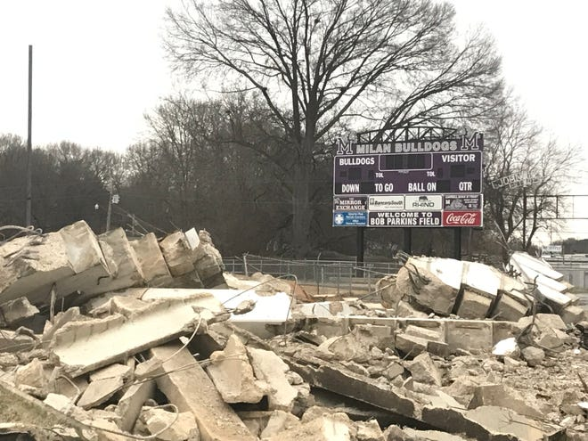 The new scoreboard at Johnnie Hale Stadium stands in the background behind the rubble of the former home bleachers in Milan.