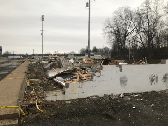 Some of the bricks are still standing among the rubble in the former home side bleachers at Johnnie Hale Stadium in Milan.