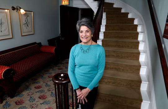 Judith Oppenheimer, external relations manager for the Decorative Arts Center of Ohio, stands at the bottom of the museum's main staircase Tuesday, Dec. 10, 2019, in Lancaster.