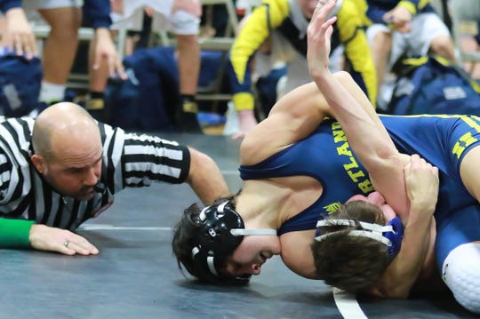 Hartland's Wyatt Nault (top) is a three-time state placer.