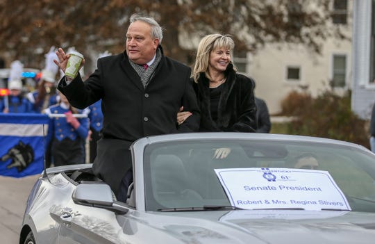 Senate President Robert Stivers and wife, Regina Stivers, ride along Capital Avenue in the Inaugural Parade for Andy Beshear.
