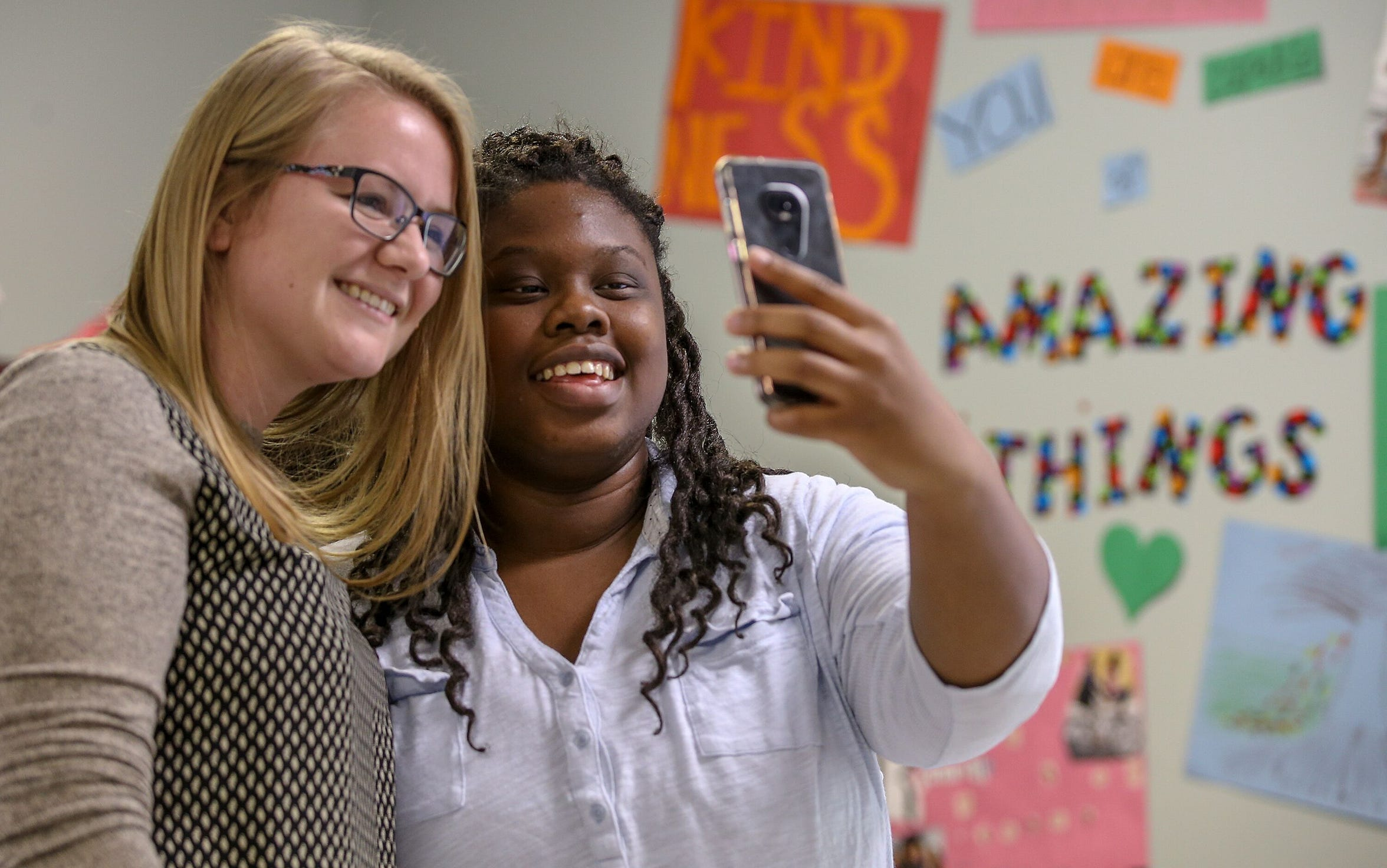 Kiki Shelton poses for a selfie with her internship instructor Carli Mosby-Smith at the Kentucky Youth Career Center in Louisville, Kentucky.