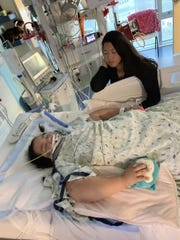 Kim Iverson with her daughter, Charlotte O'Donnell, 8, at Helen DeVos Children's Hospital in Grand Rapids in June, after she was injured in a crash.