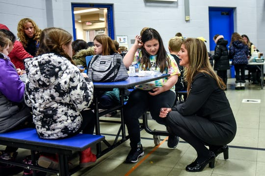 Charlotte O'Donnell, left, talks with Wilcox Elementary School Principal Traci Heuhs on Friday, Nov. 22, 2019, during lunch in Holt. One of Charlotte's main goals after her severe crash in June was to return to school.