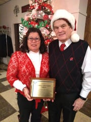 Carla and Jeff Liban received an award from the Kiwanis Club of Manitowoc in recognition of their many years of organizing and contributing to the Kiwanis Annual Christmas Party for Children with Special Needs.