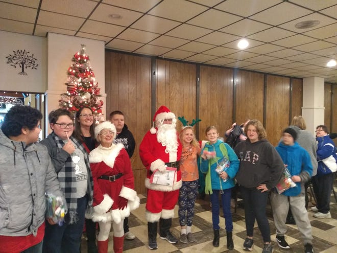 Santa and Mrs. Claus distributed goodies to all the children during the Kiwanis Annual Christmas Party for Children with Special Needs.