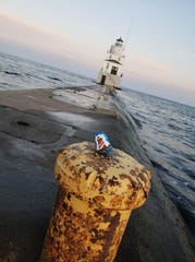 Photo of a decorated lighthouse rock 'hidden' in a creative place by Devin Stevens.
