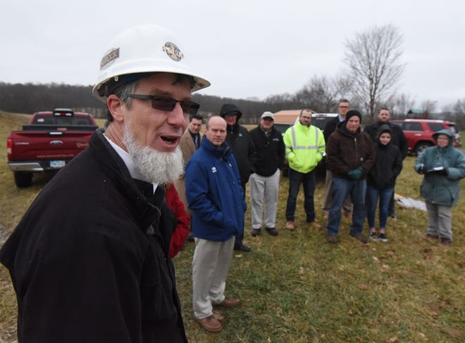 Joe Shrock speaks before the groundbreaking of a new development containing 68 half-acre lots.