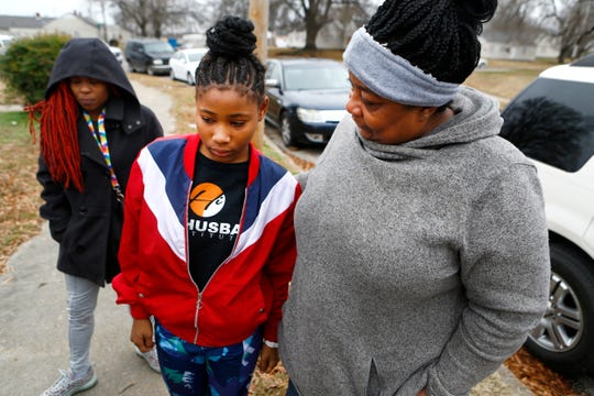 Carolyn Settles, left, comforts Arieana Parson as they mourn the loss of the girl's mother, Sierra Parson, 32, who was shot and killed late Sunday night in the Evergreen Gardens neighborhood, leaving behind 10 children ages 6-months to 15 years old.