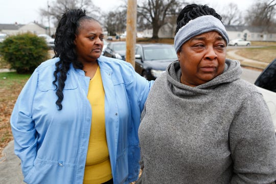Joycelyn Horne, left, comforts Carolyn Settles as she talks about the mother of two of her grandchildren, Sierra Parson, 32, who was shot and killed late Sunday night in the Evergreen Gardens neighborhood, leaving behind 10 children ages 6-months to 15 years old.