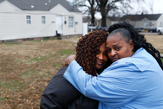Joycelyn Horne, right, comforts Jacqueline Parson as they mourn the loss of Jacqueline's daughter, Sierra Parson, 31, who was shot and killed late Sunday night in the Evergreen Gardens neighborhood, leaving behind 10 children ages 6-months to 15 years old.