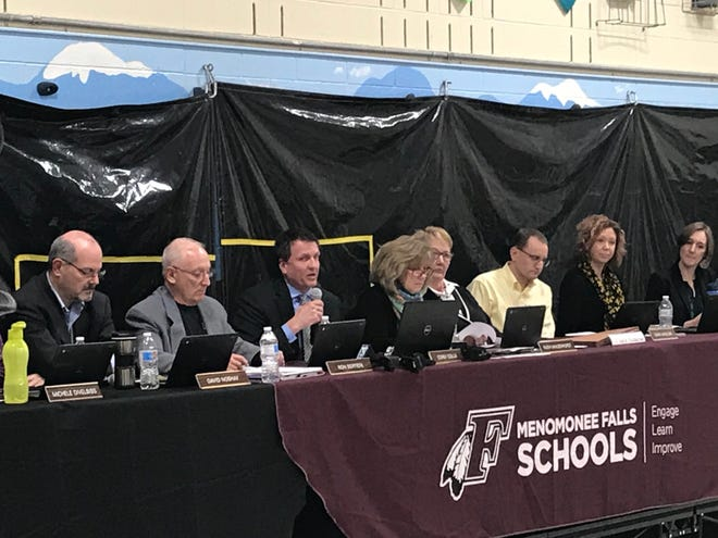 Menomonee Falls School District Superintendent Corey Golla speaks to the crowd at the Menomonee Falls School Board meeting Monday night. The board voted to retire Menomonee Falls High School's Indians nickname.