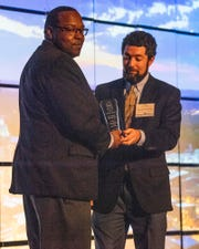 Charles Lee, of That's My Dog, is presented the Individual Impact Award by Sean Sable during the Montgomery Area Chamber of Commerce annual Meeting is held in Montgomery, Ala., on Tuesday December 10, 2019.