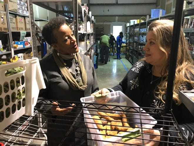 Graceworks CEO Valencia Breckenridge and mobile pantry supervisor Melissa Carter visit the organization's food pantry, which has seen a 40% increase in visitors over last year.