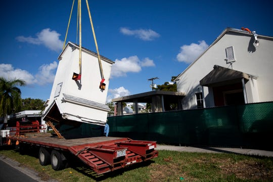 Kevin Alicea, of K&J Crane Service, sets the steeple from the original First Baptist Church down on a truck bed before the rest of the building is demolished and replaced with condos on 7th Avenue South in Naples on Tuesday, December 10, 2019.
