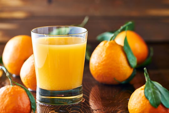 Fresh glass of orange juice.