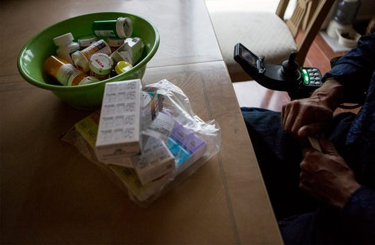 Pills that Bo Emery must take everyday for his auto immune disease overflow from a bowl on his kitchen table. Emery has been approved to use medical marijuana, but the lack of dispensaries nearby and the the laws dictating how much and when a person can buy has made it too expensive for him to get the amount he needs to ease his chronic pain.