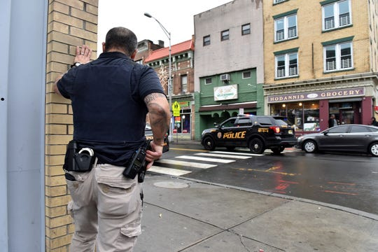 Police descended on the Greenville section of Jersey City, N.J., the scene of a deadly gunbattle on Tuesday, Dec. 10, 2019. Two suspects and three bystanders were killed, officials said, and a police detective died earlier in a related shooting.